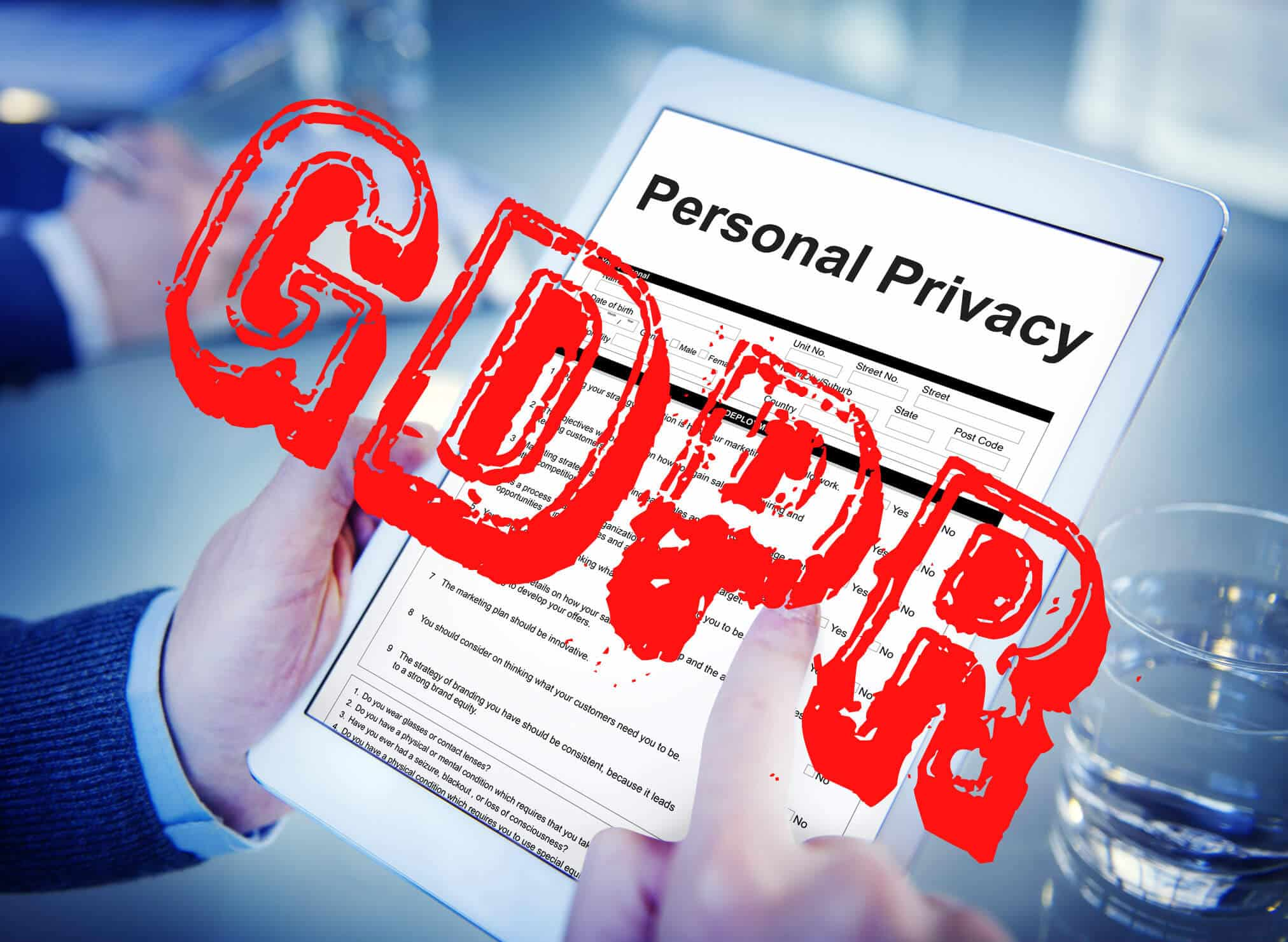 Privac form on a tablet computer, with the initials GDPR over it in red text